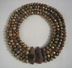 Evelien Sipkes  'Bling bling'. Necklace/object. Stoneware, mahogany, hemp, iron, gold leaf. 26 cm.