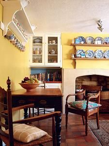 The choice of color in the kitchen makes a bright statement, lifting the terracotta tiled floor. The collection of crockery and china are on display adding color and interest to the plain walls.