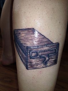 "From Allie Affinito: ""Wanted to share the recent tattoo I got, it's a card catalog [drawer]."" -- Yay!"
