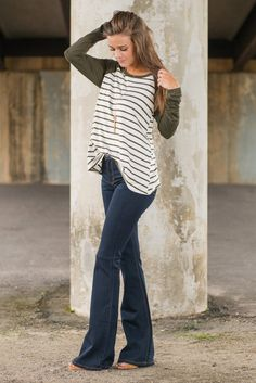 """Spice Up Your Life Flare Jeans, Denim"" These flared dark wash jeans will spice up any wardrobe! Flare jeans are just so hot right now! #shopthemint #newarrivals"
