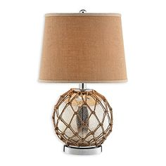 Enliven your living space with the nautical style of the Stein World Marina Glass Table Lamp. This lamp features a spherical glass base covered in a webbing of rope and a matching linen hardback shade. Perfect fora seaside vacation home.