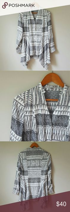{WD.NY} V-Neck Aztec Print Shark Bite Blouse -Unique blouse  -100% polyester  -Silky, light-weight fabric -Button up blouse (hidden front buttons)  -Black & white  -Worn 2-3 times, excellent condition! ⭐HP 9-12-16 Best in Tops ⭐HP 9-20-16 Fall Favorites  ⭐HP 9-22-16 Style Obsessions    by @alinasher WD.NY Tops Blouses