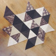 Hannah Jane Fellows: Tessellation table topper - Grey and white English Paper Pieced work