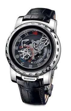 "Ulysse Nardin's Freak Diavolo tells the time via ""hands"" which are really parts of the watch's movement, with a flying tourbillon indicating the seconds. To set the time, one has to rotate the bezel rather than setting the ""hands"" via a crown."