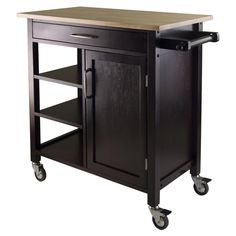 Add storage space in your kitchen or dining area with this Breakwater Bay Collins Beach Kitchen Cart. It is made of a combination of solid and composite wood, which ensures strength and durability. It has a wainscot panel finished in black, which complements most kitchens. This kitchen cart has an open storage space on one side with an adjustable shelf. The other side has a closed cabinet with one adjustable shelf. The table top acts as a chopping station, making this cart a functional…