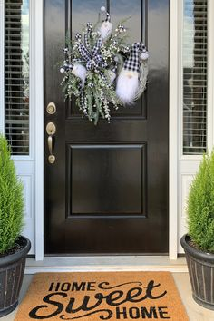 Decorate your holiday door with a buffalo plaid gnome Christmas Wreath with lots of greenery and ribbon for a festive look by Southern Charm Wreaths
