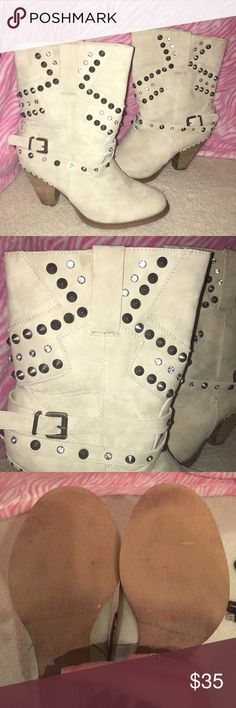 Boots from Buckle -Not Rated Brand Only worn once! Still in great condition. Perfect for a night out. Super sassy with straps and tiny spikes on boots! Buckle Shoes Heeled Boots