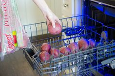 1. Rinse the dirt off potatoes in the top rack.
