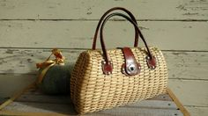 Check out this item in my Etsy shop https://www.etsy.com/listing/483884316/retro-1960s-wicker-rattan-purse-with