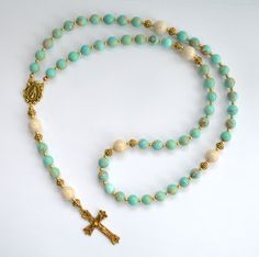 Gemstone Rosary Beads Aqua Terra Jasper and Riverstone gemstones. All Rosary Beads are made to order. Please allow 2-3 weeks for shipment. Shipping Most jewelry is made to order. Therefore, please all