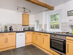 The modern kitchen with feature oak beam and stone flag floor!