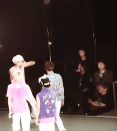"""*Jonghyun blows a kiss* (Onew catches it) + Minho tries to steal another one + (Key is rushing everyone off of the stage), while Taemin is forever embarrassed yet slightly entertained by his hyungs"".   Basically, SHINee being...SHINee.  (.gif set)."