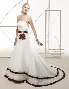 This couture wedding dress features strapless bateau neckline, beaded bust line. Burgundy waistband across with big bow in side front. Flare out skirt decorated by same bandages to the hem., lace trimming accented. Cute bows beaded to the centre lien of the back.