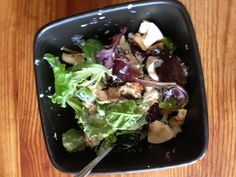 Spring mix salad with mushrooms, green peppers, onions, goat cheese and dressing