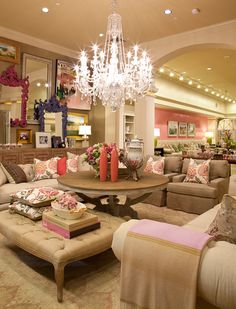 Glamorous living room! Love the collage wall of baroque frames + mirrors!! LOVE the chandelier ♥