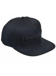 THE BLACK EMB CAP 5 panel snap-back cap.