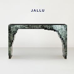 Joe Console in green mica and black lacquer. Designed by Jallu, mica furniture, green mica furniture, green furniture, Jallu Creations 2021, interior design, super yacht interiors, luxe, french craftsmanship, bespoke furniture, custom furniture, made in France, interior design inspiration, design inspiration