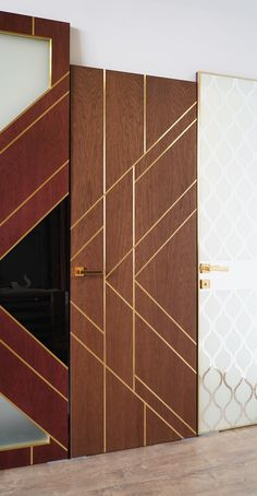 The original interior door in the art deco style by Stavros. Oak veneer. Brass insert decor.