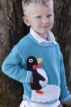 Free Knitting Pattern for Penguin Pullover - Long-sleeved child's sweater with a cute penguin who hides a convenient pocket. Sizes 2, 4, 6. Designed by Amy Bahrt for Cascade Yarns.