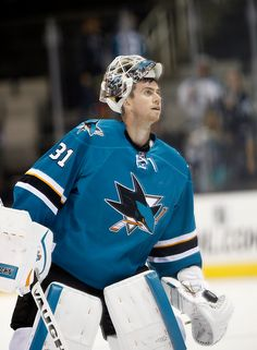San Jose Sharks goaltender Martin Jones prepares to toss a puck to a young fan after being named the first star of the game (Sept. 29, 2015).