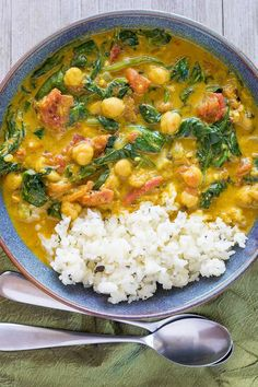 Instant Pot Chickpea Curry with Spinach and Tomatoes - A quick, flavorful dinner in under 30 minutes! This easy, plant-based curry dish is also always a hit at potlucks and family dinners. #easydinner #plantbased #curry