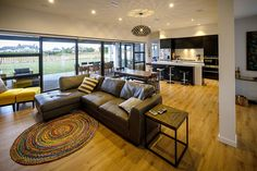 Brodie & Niki Retallick's open plan family room with dark leather modular sofa. #house #familyroom #interiordesign #brodieretallick #generationhomes