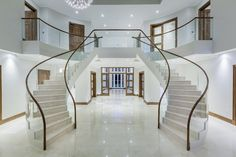 Luxury Stairs Gallery: New English marble double stairway with wood and curved glass railing Luxury Staircase, Double Staircase, Staircase Design, Crowded House, Stair Gallery, Ultra Modern Homes, Concrete Stairs, Glass Railing, Glass Stairs