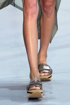 Taupe slide sandals at Lacoste spring '16.
