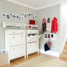 Ideas for a narrow hallway - love how this example incorporates so much storage. Bright, airy colours too.