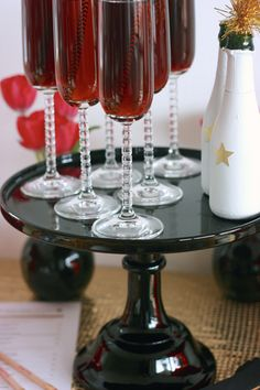 Prosecco mixed with pomegranate juice, our favorite mixer in the winter. | MomTrends