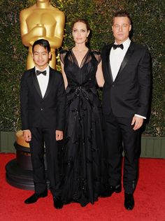 HOLLYWOOD, CA - NOVEMBER 16:  (R-L) Actor Brad Pitt, actress Angelina Jolie and son Maddox Jolie-Pitt arrive at The Board Of Governors Of The Academy Of Motion Picture Arts And Sciences' Governor Awards at Dolby Theatre on November 16, 2013 in Hollywood, California.  (Photo by Jon Kopaloff/FilmMagic) via @AOL_Lifestyle Read more: http://www.aol.com/article/entertainment/2016/09/26/jennifer-aniston-evil-eye-necklace-brangelina-divorce/21479570/?a_dgi=aolshare_pinterest#fullscreen