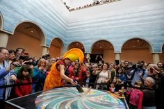 Monks from Drepung Loseling Monastery created a beautiful sand mandala symbolizing the road to Enlightenment in the Blanton's Rapoport Atrium. After five days of intricate work, the completed mandala was displayed for 30 minutes before being disassembled and dispersed into Waller Creek in a closing ceremony that represented the impermanence of all that exists.