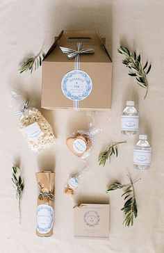 Wedding Gifts For Guests Like this container idea. We can make up a bunch of these ahead of time and then put them out for guests. Welcome bags Wedding Welcome Gifts, Destination Wedding Welcome Bag, Wedding Gift Boxes, Wedding Gifts For Guests, Wedding Guest Bags, Wedding Table, Creative Wedding Favors, Inexpensive Wedding Favors, Beach Wedding Favors