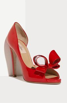 Couture Bow d'Orsay Pump | Valentino, via Nordstrom | A bold oversized bow tops the peep toe of a glossy patent leather pump with a curvy d'Orsay cutout at the side. #shoes #red