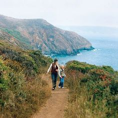 Hiking in Marin Headlands, Sausalito, CA.   Join the parade of cars winding up twisty Conzelman Road to Hawk Hill, but don't stop there. Drive a bit farther to the beach parking area on your left, and you'll see signs for the trail to Black Sands Beach. The 0.75-mile hike down (slightly rickety) steps is sure to put the rosy in your cheeks, and the narrow strip of beach is windy, wild, and stunning. Another great spot is the Tennessee Valley Trail.
