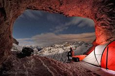 Photo by @shonephoto (Robbie Shone) looking out of the entrance to Conturines cave over the Dolomites in Italy. I was camping there with a team of geologists from the University of Innsbruck as part of a field campaign collecting very old flowstone samples for past climate research from this site of interest. This cave is famous for the collection of bones and skulls that are found inside from cave bears, which are now an extinct species.