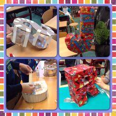 Grote Sinterklaasletter, gemaakt van karton, bekertjes, en tape. Papier maché met kranten en Sinterklaas inpakpapier. Kinderen zijn erg enthousiast. (Groep 8)