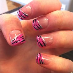 Hot pink zebra nails with a strip of glittery silver underneath