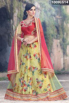 Yellow net lehenga beautified with stone, zari, resham embroidery and patch border work. Red, yellow art silk and net choli and red net dupatta are available with this.Price US$ 84