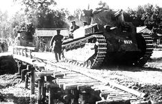 A Japanese tank passes over an emergency bridge, somewhere in China, on June 30, 1941. (AP Photo)