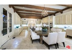 Listing #15943979A spectacular Mediterranean estate in prime Holmby Hills that embraces the beauty of Italian renaissance design. Enter the dramatic two story grand foyer that boasts 26ft beamed ceilings, elegant archways, and an abundance of impeccable craftsmanship throughout. Main level features private office, living room, maids quarters, billiard room, card room with impressive wrought iron doors, walnut paneled wet bar & formal dining room that opens to an expansive rear yard with…