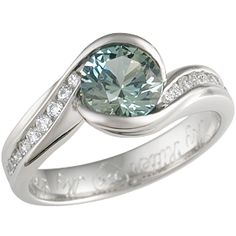 Carved Wave Engagement Ring with Green Sapphire - An organic, flowing ring, the Carved Wave gracefully winds around the finger and around the diamond in waves and eddies. Channel-set diamonds, sapphires or birthstones accent the band, giving a line of brilliance to either side of the center stone.  4mm wide, 0.18 ctw ideal cut diamonds. - This one-of-a-kind ring showcases an unusual green sapphire.