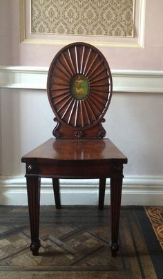 An Irish mahogany chair in the entrance hall of Rokeby, County Louth.  This handsome chair is one of a set believed to date from the end of the 18th century and attributed to Mack Williams and Gibton. However, since that business was only established around 1812, the chairs could be earlier, made perhaps when John Mack was still working by himself (until 1801). They all bear a peer's coronet so certainly belong to some date after Archbishop Robinson was created first Baron Rokeby in 1777.