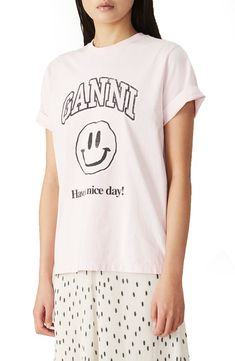 A smiley face, a happy greeting and a low-key reminder front a cherry-blossom-pink organic-cotton tee with a logo graphic. Style Name:Ganni Happy Face Organic Cotton Graphic Tee. Style Number: 6045978. Available in stores. Anniversary Sale, Cotton Tee, I Dress, Organic Cotton, Graphic Tees, Short Sleeves, Fashion Outfits, Low Key