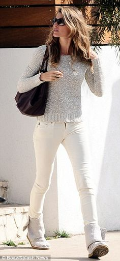 Monochrome: gorgeous in her marbled beige jumper, white skinny jeans, and matching boots