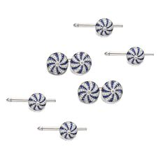 DIAMOND AND SAPPHIRE DRESS SET. Comprising a pair of cufflinks and four studs, each domed circular link decorated in a pinwheel motif with calibré-cut sapphires and small round diamonds, the total diamond weight approximately 2.75 carats, mounted in platinum.