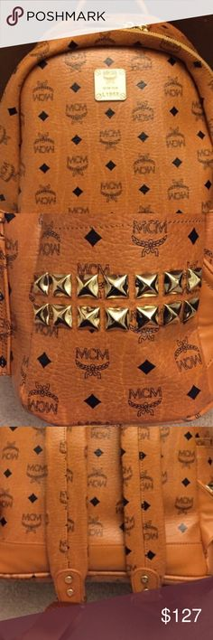 Mcm book bag.( read description) Most people lie, but I'm one honest person.before you ask this is a a good quality Rep. so no not authentic. However price shows reflection. Bought a real one, no one can tell bc it's just like a real one a very high quality no one I know ever could tell unless I said so. Just want to be fair to the posher who is interested. It's medium size shark mcm book bag. MCM Bags Backpacks