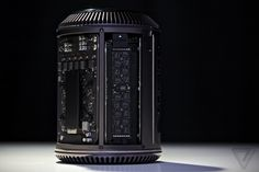 "MacPro V 2013 – black Cylinder revolution! Order 2013-12-19! ""Can't innovate anymore, my ASS"" • Previewed Apple WWDC 2013-06-10 • 1st new industrial design in 8 years! • REVIEW by The Verge 2013-12-23"