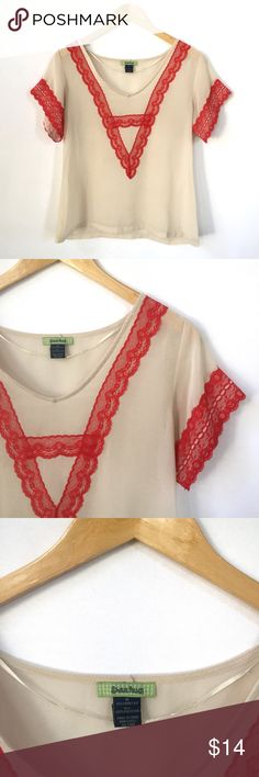 Cream Top with Red Lace Sheer cream top with red lace accents on sleeves and neck. 100% polyester. Underarm to underarm - 19.25 inches, length - 22.5 inches. *All measurements are approximate and taken laying flat. Free Hug Tops