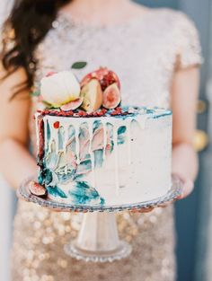 Unique watercolor wedding cake: http://www.stylemepretty.com/texas-weddings/dallas/2017/03/23/glittery-gold-engagement-session/ Photography: Alla Rose - http://www.albarosephotography.com/